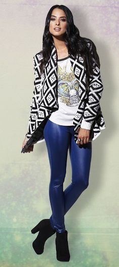 Graphic tee and sweater, bold blue skinny pants.