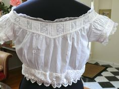 "1850 60 Antique Corset Cover Camisole Chemise Cotton Off The Shoulders Design | eBay seller airkit1010; handmade button holes & embroidery; seat guard on inside, drawstring waist; ribbon is not original; waist: 23"" - 30"""