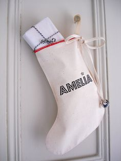 custom christmas stocking : cotton, printed with any name, cotton bow with bells, cute holiday decoration. $14.00, via Etsy.