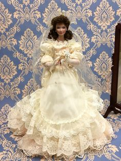 """`A Vision of bliss""""  First issue in Private Moments:  a Bridal Album by artist Sandra Kuck  for The Ashton-Drake Galleries  this doll begins the collection, in her sumptu-ous, lace-trimmed gown, complete with her standing cheval mirror. Approx cm 43."""