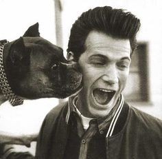 Chris Isaak and friend. . ..