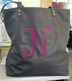I'm obsessed with the around the town tote in Charcoal with raspberry personalization! www.mythirtyone.com/paigecress03