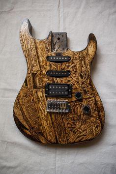 Saint Cordula's relyquary pattern on electric guitar. Pyrographyed by Psujek Arts