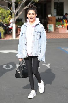 Madison Beer wearing Nike Air Force 1 Sneakers and Givenchy Studded Antigona Bag