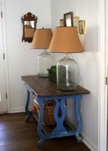 WHAT A GREAT IDEA!!!!! Chair backs used as table legs.... Brilliant! and 2 large glass jugs as table lamps