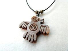 SPIRIT BIRD PENDANT / handcarved on olive wood by MassoGeppetto