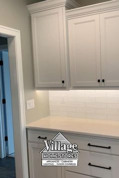 Surrounding the hood are tall wall cabinets staggered in height and depth. The base cabinet layout consists of mostly large drawers. These drawers provide lots of accessible storage for pots, pans, baking dishes, and even small appliances.