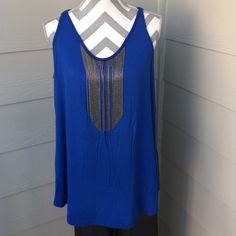 Royal blue dressy tank top Beautiful Royal Blue dressy tank top accented with silver chains hanging over the bust line to add just enough pop to take it up a notch. Brand is Sydney Gregory !! Sydney Gregory Tops Tank Tops