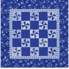 Blue-and-White Pinwheel Quilt Add depth to a two-color quilting project with a variety of prints. Multiple blue-and-white prints in medium and light hues provide subtle scrappiness for this wall hanging.