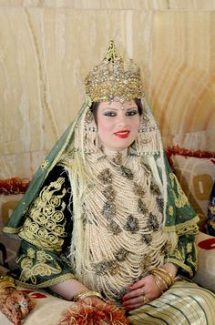Ethnic Clothing The traditional costume of Tlemcen is an Algerian dress composed of several layers of clothes and accessories linked to different Mediterranean civilizations. It is called CHEDDA.   A fabulous experience...and a huge challenge!