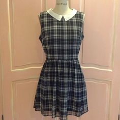Like New Navy Plaid School girl Dress Fully Lined with a side zipper, white collar,navy and white school girl dress. Super cute with white keys or combat boots.  Worn with a navy sweater when chilly. Forever 21 Dresses