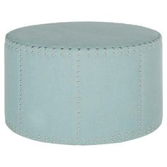 A sophisticated addition to your living room or den seating group, this nailhead-trimmed ottoman features sky blue upholstery and a timeless silhouette.