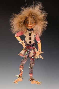 wild-haired paper doll