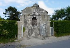 "At la Madeleine, a hamlet of the town of Sainte Marie du Mont, Utah Beach area. A group of U.S. Fire Engineering leaving the chapel."" (Ghosts of WWII)"
