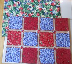 """Handmade and One-of-a-kind~ Reversible placemat set with a Berry Basket theme.  Your table couldn't get much cuter!  Set includes 4 placemats.  Placemats measure 16."""" x 11.5"""" and are fully machine washable on delicate cycle, lay flat to dry and press with a warm iron as needed."""