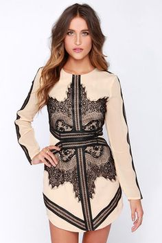 Look close, what do you see? Because we see the Rorschach Test Beige and Black Long Sleeve Dress is about to make your best day even better! This woven poly beige dress has plenty of enviable features, from its long sleeves and round neckline, to the elegant display of lace and vegan leather trim that adorns this shift dress. Bold strips of vegan leather border patterns of sheer floral eyelash lace on the bodice, and continue around the back forming a chic waistband. Matching trim decorates…