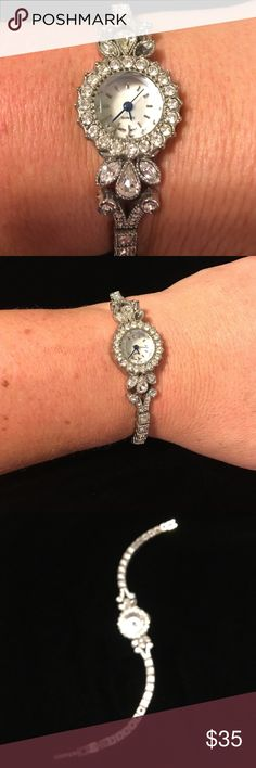 BF-SALE 40%⬇️Tennis bracelet style watch Elegant demur Tennis bracelet style watch- one rhinestone missing (see first pic above face in right. Face is an iridescent light Pearl with tinge of pink.   Perfect working order just had battery replaced 11-16-16 Price is FIRM❣️but you can bundle & save! This is the Lowest price for this item❣️❣️ ☑️I ship same or next day!! Accessories Watches