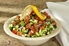 Shirazi Salad- Diced tomato, red onion, cucumber, and parsley with lemon juice and olive oil dressing