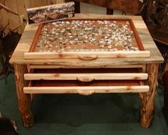 Aspen wood Puzzle table from the Mad Moose in Estes Park Colorado. WAY cool. You can be working on 3 puzzles at once and when the drawers are shut it is just a normal table.
