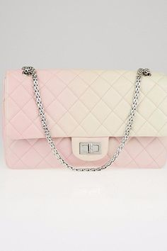 Want a limited edition unique Chanel bag for your summer parties? Look at this Pink and Cream flap bag, which is super rare! Starting at $100 a week, this two toned beauty is perfect to pair with your summer dresses