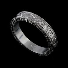 This graceful wedding band is made of 14k white gold. Ring is beautify engraved 3/4way on the sides (that allows to do re-sizing), miligrained on the