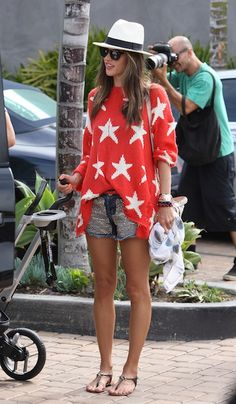 Alessandro Ambrosio in an adorable Wildfox sweater, studded cutoffs, simple sandals and a cute fedora!