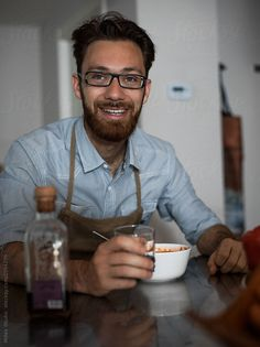 Man eating vegetarian soup at home after cooking