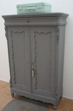 Beautiful dark grey cabinet.