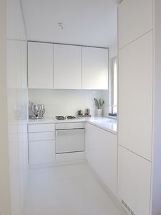 All white small kitchen, would add a little colour or sparkle but perfect for lack of space