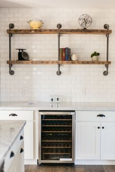 Gas pipe and reclaimed barn wood shelf in lieu of upper cabinetry - by Rafterhouse.