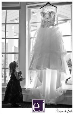 Flower girl looking at wedding dress at Sherwood Country Club - Follow Us:   http://pinterest.com/sherwoodcclub/  http://www.facebook.com/pages/Sherwood-Country-Club-Events-Weddings/120564331343926?ref=hl