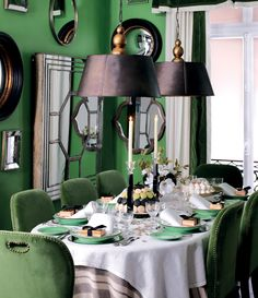 Green dining room. Green chairs. Green walls. Black Pendants. We've decorated with strong colours for a hefty dose of Parisian Chic. Dark metal pendants with gold fittings deliver a theatrical touch, which is reiterated by a playful collection of mirrors - OKA Direct