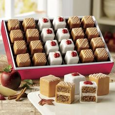 Caramel Apple Petits Fours $19.99 Luscious layers of apple-walnut cake and caramel butter creme are coated with rich Swiss creme and hand-decorated. Gift of 24; .51-oz. each.