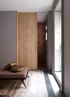 Chelsea-Townhouse-by-Archi-Tectonics: space saver with sliding panel doors along the hallway