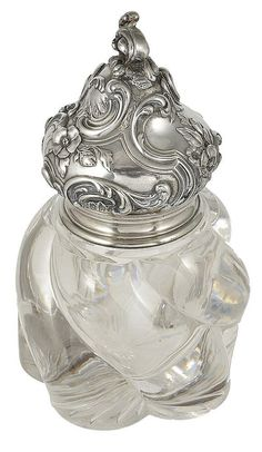 A RUSSIAN SILVER-MOUNTED GLASS INKWELL, FABERGE, WORKMASTER JULIUS RAPPOPORT, ST PETERSBURG, LATE 19TH CENTURY. The glass body of bold swirled ribs, the onion-domed silver lid cast and chased with rocaille scrolls and flowers.