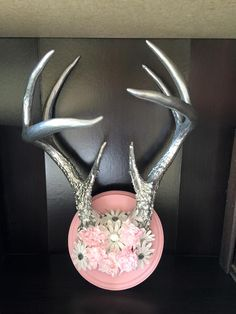 I totally glammed up these deer antlers and mounted them on a chalk painted round board.  Instant girly glam for hanging jewelry.  For sale in our booth for $45!