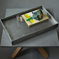 lacquer tray on the coffee table - perfect for art books, picture frames, decorative items. <3