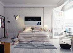 chambre adulte avec des briques de parement en tant que déco murale