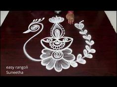 It is our tradition to draw kolam every day morning at the door steps. There are many benifits of drawing kolam in front of the house. It is auspecious and b. Rangoli Designs Latest, Rangoli Designs Flower, Rangoli Border Designs, Small Rangoli Design, Colorful Rangoli Designs, Rangoli Ideas, Rangoli Designs Diwali, Rangoli Designs Images, Beautiful Rangoli Designs
