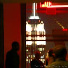 Empire State Building At Night Thru Window - Artistic Photography by Patrick Malon