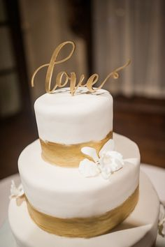 This brushed gold wedding cake is nominated for #CJsBestof2015! Photo by Alex Thornton Photography #goldweddingcake #goldweddingtopper #brushedgold #goldweddingdecor