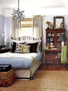 Bed against window with secretary as bedside table.  Moravian star.  Nice and neutral.