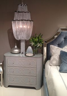 #Glam for the bedroom! Say goodbye to boring #nightstands!  #Upholstered chest with nailhead design and glass top by #Bernhardt. IHFC #hpmkt #stylespotters #blue #glamour