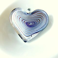 Black and Blue Bruised Heart Pendant. Lampworked by FloridaQuarry