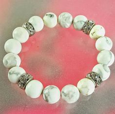 """HANDMADE WHITE HOWLITE GEMSTONE BRACELET Summer is soon approaching, time to lighten those accessories...let me help by offering this cool, earthy Howlite Bead bracelet. The bracelet is comprised of 10 mm Howlite (white) gemstone beads with Rhodium Plated Pave Crystal Accent Beads. Approximately 7"""", handmade, unique... Unlike my description, so typical and boring... lighten those accessories?? What am I on QVC?? Rhinestones & Razorblades  Jewelry Bracelets"""