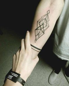 Geometric inner forearm and armband tattoos