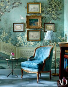A painted floor by Chris Pearson and a Gracie wallpaper add a whimsical touch to the master bedroom. Bergère purchased at auction; lamp from John Rosselli Antiques.