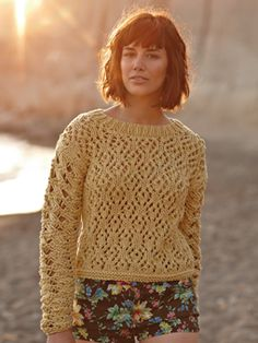 Knit this womens openwork sweater from the All Seasons Chunky Collection, a design by Marie Wallin using the lovely yarn All Seasons Chunky (cotton and acrylic). With full length sleeves, a beautiful lace stitch pattern across the main body and a stunning cable drop stitch pattern on the sleeves, this knitting pattern is for the experienced knitter.