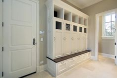 Collection of 22 incredible mudroom ideas, all with storage lockers and/or benches. Mudroom storage helps keep your home entry organized and clutter-free. Home, House Styles, House Design, Locker Storage, Mud Room Storage, Mudroom Design, Mudroom Laundry Room, Wood Lockers, Built In Lockers