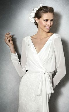 Pronovias 2017 / The wisdom and skill of expert seamstresses transform fine fabrics into haute couture designs. These wedding dresses are pure magic. Pronovias has designed a collection to enchant not only romantic, classic brides, but also modern, Modest Wedding Dresses, Bridal Dresses, Wedding Gowns, Wrap Wedding Dress, Mature Bride Dresses, Relaxed Wedding Dress, French Wedding Dress, Plain Wedding Dress, Pronovias Wedding Dress